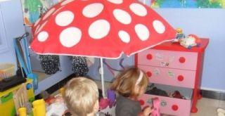 Wie heeft er een parasol met voet?